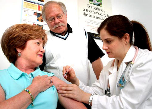 Image of two seniors getting a flu shot -- CDC Public Health Image Library No9306
