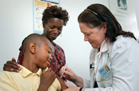 Image of an African American youth getting a flu shot -- CDC Public Health Image Library