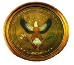 dark gold circle with image of an eagle in the middle; logo of Tompkins County New York local government