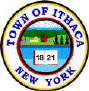white circle, blue letter, colorful drawing of the lake, trees, a farm; the logo of the Town of Ithaca New York