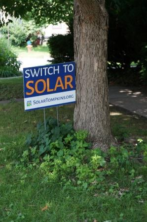 Yard sign that reads switch to solar.