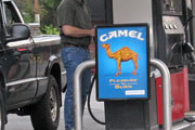 Your kids learn about cigarette brands while you pump gas! How convenient!